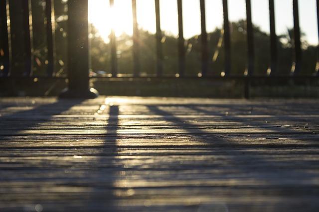 sun reflecting on a wood deck