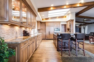 Galley-style kitchen with island and wood cabinets