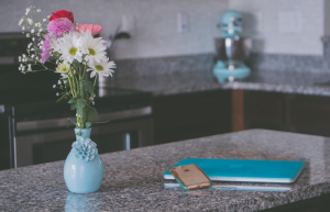 Flowers in vase, computer, and phone on countertop, Anne Arundel County, Johnson Lumber