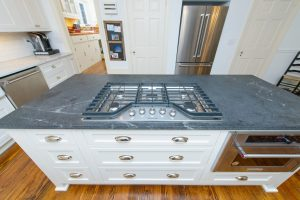 Slate blue countertop with in-mounted stove top