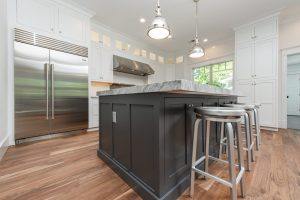 Kitchen redesign showing white ceiling-height cabinet