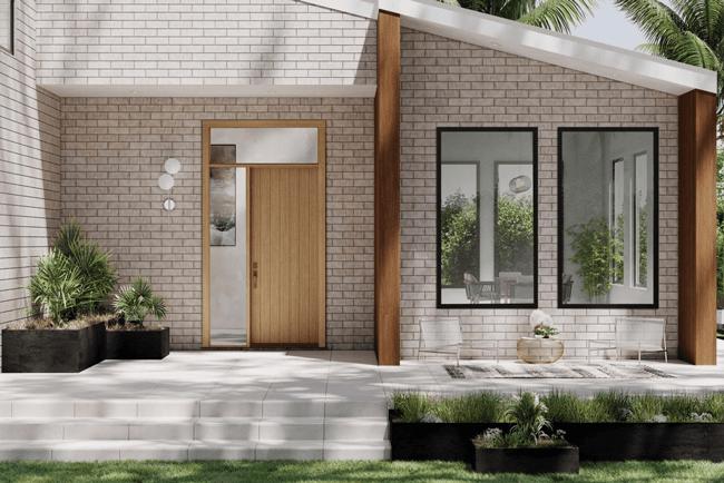 beige brick home with Marvin Entry door